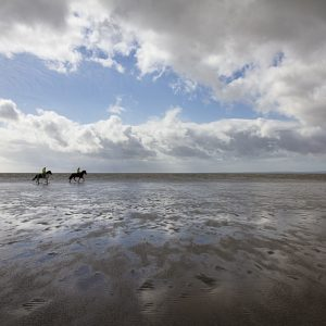 Riders on the Ebb Tide - Photograph