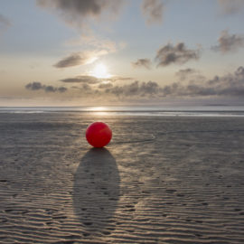 Lost Buoy at Sunset - Photograph by Debbie Yare
